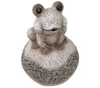 Magnesia-Frosch auf Kugel, sand